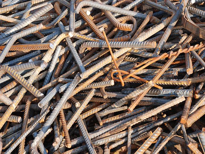 Scrap metal pile of poles